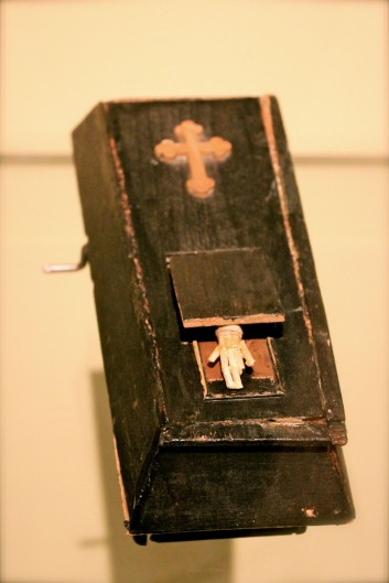 A 19th Century Czech wind-up toy coffin, with a moving skeletal hand - Prague Ethnographic Museum