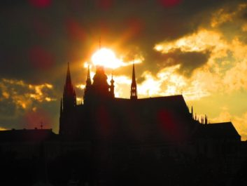 THE SUN CROSSES THE GREAT SOUTH TOWER OF ST VITUS' CATHEDRAL.