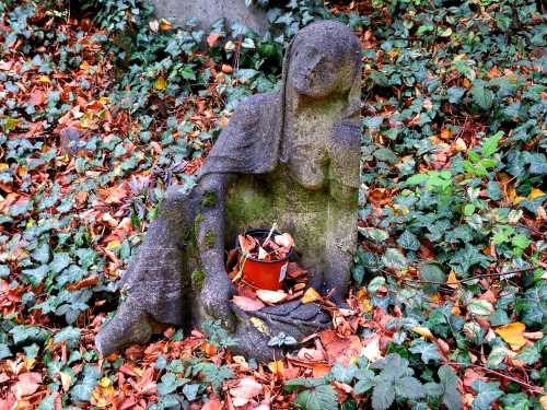 resting woman in a cemetery in Prague